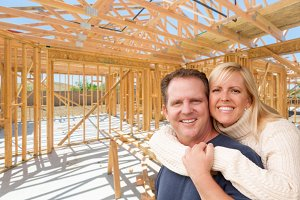 Couple Inside Home Construction Site