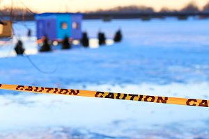 Caution sign of thin ice