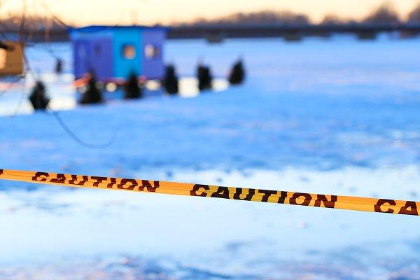 Caution sign of thin ice