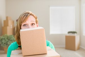 Woman with Moving Boxes In Room