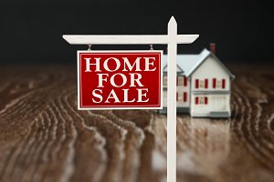 Real Estate Sign & House on Wood