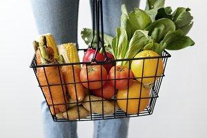 Woman holding vegetable basket