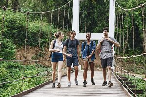 Friends walking on the bridge