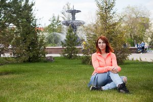 Woman sitting in city park