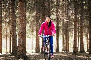 Woman  rides a bike
