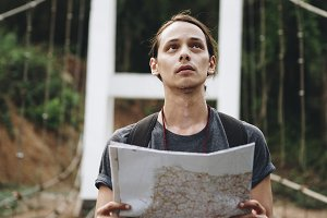 Caucasian man looking at a map