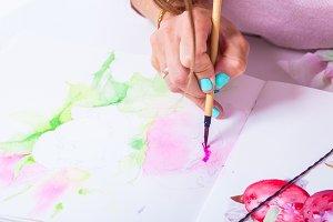 Woman  draws  flower