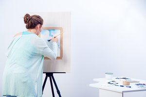 Woman artist paints