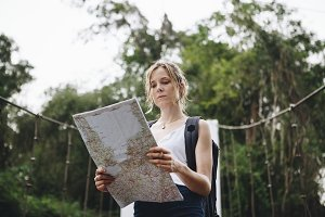 Caucasian woman looking at a map