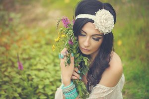 Boho Girl with bouquet of wildflower