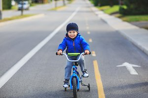 Picture of happy child on a bicycle
