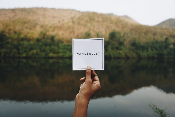Wanderlust text in nature