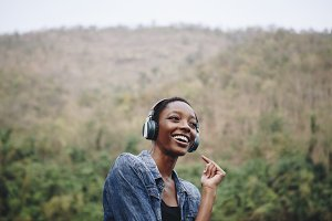 Woman listening to music in nature