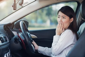 Woman feel tried sleeping in a car