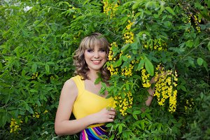 Spring girl in yellow flowers