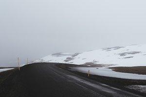 Winter Road through Snow Landscape