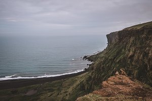 Cliffs and Coastline with Clouds