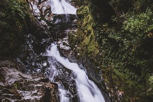 Waterfall in Dark Tropical Forest