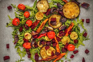 Grilled vegetables on rocket bed