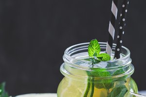 Cold lemonade mojito in a glass jar