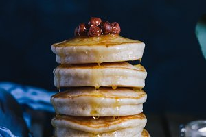 Stack of pancakes with honey and nut