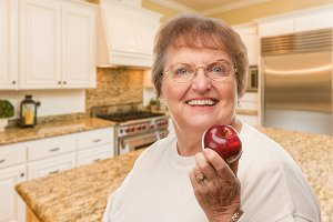 Senior Adult Woman with Red Apple