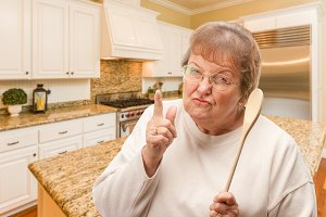 Senior Adult Woman With Wooden Spoon