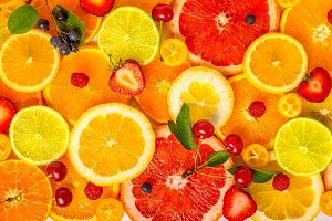 sliced mixed citrus fruits backgroun