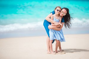 Family fun on white sandy beach. Mother and little kid enjoy summer vacation