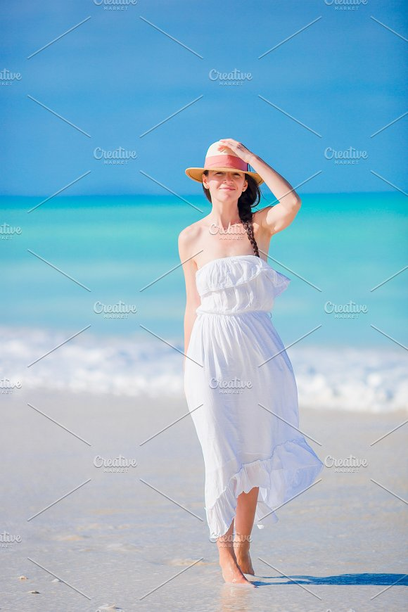 Young Beautiful Woman On White Sand Tropical Beach Caucasian Girl With Hat Background The Sea