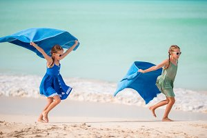 Little cute girls on the beach