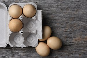 Brown Eggs Carton Wood Table
