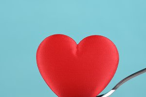 Red Heart on Spoon Teal Background