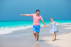 Family fun on white sand beach