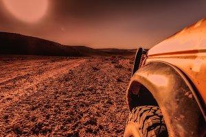4x4 vehicle, desert and sunset