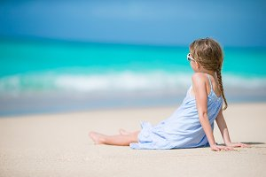 Adorable little kid at beach during summer vacation