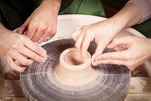 Potter sculpts a vase