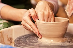 Woman potter sculpting