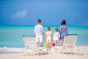 Family of four on beach vacation