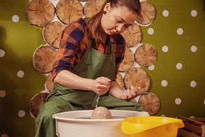 Potter works on a potter's wheel