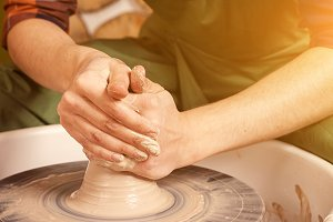 Potter works on a potter's wheel