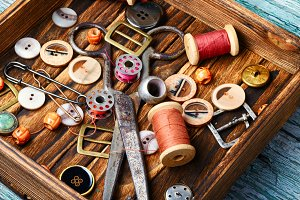 Sewing buttons and spools of thread