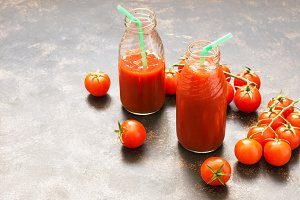 Fresh tomato juice in glass bottles