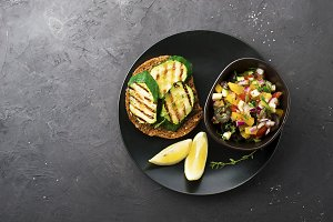 Toast with zucchini grill and salad