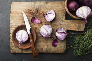 Red onions on an old vintage wooden