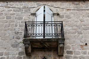old iron balcony in an old stone house