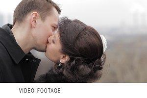 Bridal pair kissing.
