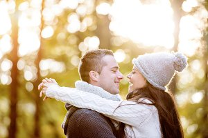 Beautiful young couple in love, hugging. Sunny autumn nature.