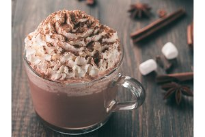 Glass cup with hot chocolate and whipped cream