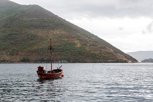 old wooden ship stands in Boko Bay of Kotor in Perast